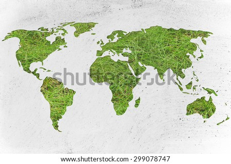 environmental awareness and green economy: illustration with map of the world made of green grass