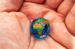 Environmental awareness, global warming consciousness and aspirations to protect future of the planet conceptual idea with close up on hand holding the earth in the open palm