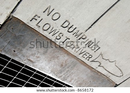 Environmental awareness notice on public drainage.