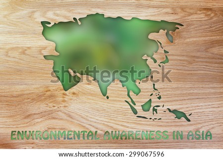 environmental awareness throughout the world: illustration with map of asia made of green leaves blur