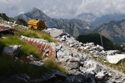 Environmental degradation. Environmental degradation in the mountains of Alta Versilia. Old compressor and iron sheets in an abandoned marble quarry. Alpi Apuane, Tuscany, Italy.