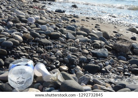 environmental disaster in nature, dirty seashore and beach in the trash, garbage disposal from the rest, camping in nature, plastic and harm to human health, sea animals and plastic debris, greenpeace