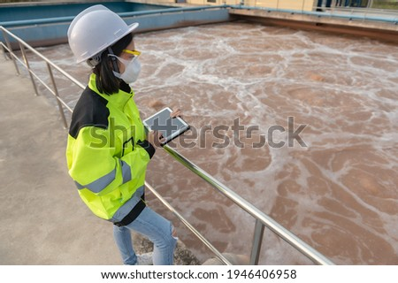 Environmental engineers work at wastewater treatment plants,Water supply engineering working at Water recycling plant for reuse Foto stock ©
