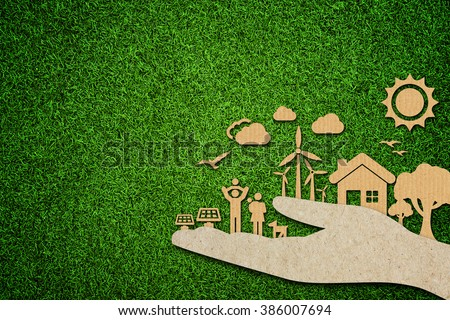 Environmental green energy concept with cardboard cut out on green grass.