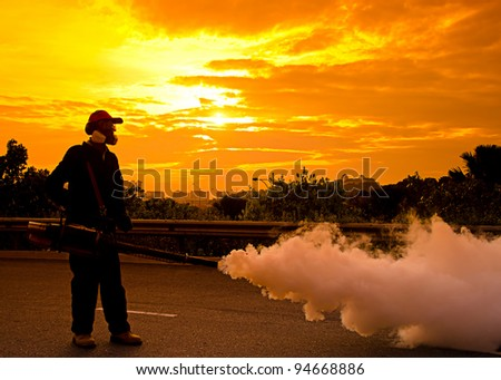 Environmental health workers are fogging to control dengue during sunset