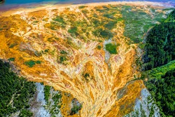 Environmental pollution from the extraction of copper ore and copper pyrite. View from above. Dead soil and forest