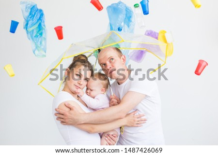 Environmental pollution, plastic recycling problem and ecology problem concept - sad family under garbage on white background.