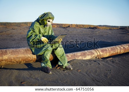 Environmental scientist working in the zone of ecological disaster