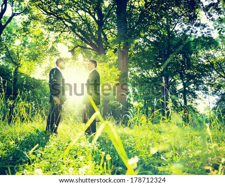Environmentalist Businessmen Shaking Hands in Green Park