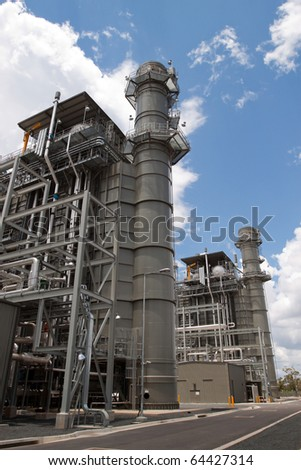 Environmentally advanced technology using methane gas to produce low greenhouse emission electricity.  Clean energy production with copy space.  Vertical image.