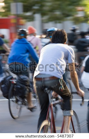 Environmentally conscious bikers in traffic. Motion blur on the subjects. - Shutterstock ID 5487307