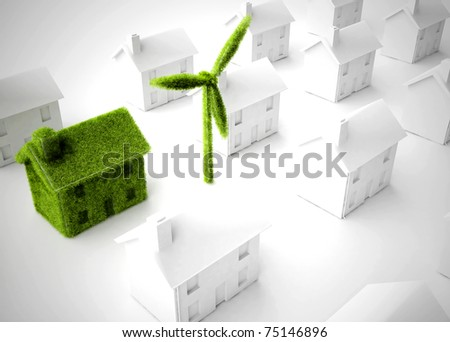 Environmentally friendly Eco house with wind turbine among many non-environmentally friendly houses