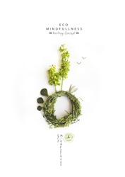Environmentally friendly planet. Green trees on the planet, made of green grass and  leaves, isolated on bright background. Minimal nature concept. Think Green. Ecology Concept. Flat lay. Top view.