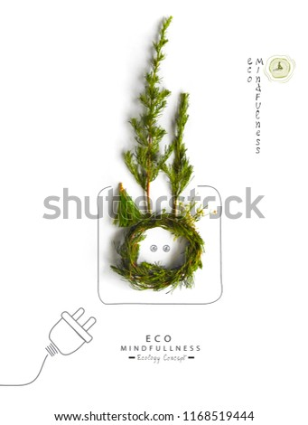 Environmentally friendly planet.Symbolic earth globe with pruces and trees, made of green grass and hand drawn cartoon sketches wire plug and socket in the globe.  Green energy electricity concept.
