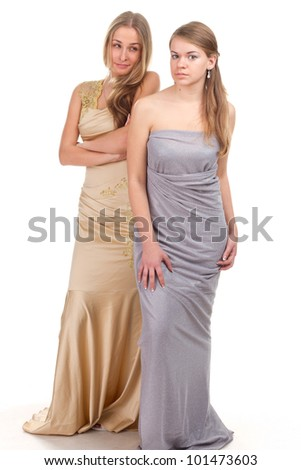 Envy of her friends - two friends in the gold and silver dress on a white background