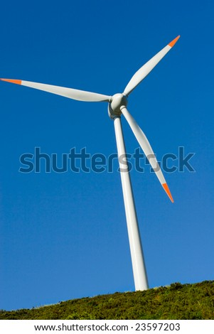 eolic Turbine Agaist Clear Blue Sky and Sun