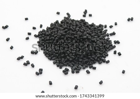EPDM rubber granules . Colored Rubber Granules on white background. Plastic polymer granules.