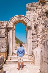 Ephesus ruins, Turkey, young man walking between the ruins of Ephesus Turkey