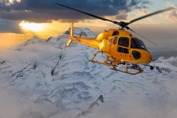 Epic Adventure Composite of a Yellow Helicopter flying over the Glacier Mountain during a dramatic sunset. Aerial Landscape of Mnt Baker in Washington, USA, near Seattle.