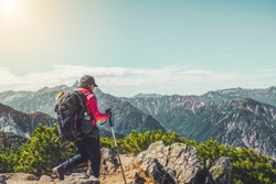 Epic adventure of hiker do trekking activity in mountain of Northern Japan Alps, Nagano, Japan, with panoramic nature mountain range landscape. Motivation leisure sport and discovery travel concept.