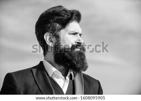 Epic beard growing guide. Man bearded hipster wear formal suit blue sky background. Vintage style long beard. Facial hair beard and mustache care. Beard fashion trend. Invest in stylish appearance.