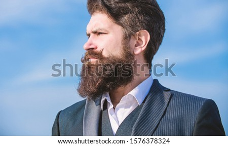 Epic beard growing guide. Vintage style long beard. Facial hair beard and mustache care. Beard fashion trend. Invest in stylish appearance. Man bearded hipster wear formal suit blue sky background.