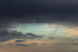 Epic Dramatic Storm sky, dark grey clouds against blue sky background texture, thunderstorm