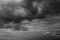 Epic Dramatic Storm sky, dark grey rainy clouds with wind, abstract background texture, thunderstorm. Black and white photo