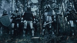 Epic Invading Army of Medieval Soldiers Standing in Forest Ambush. Armored Warriors with Swords, Getting Ready to Attack. War, Battle, Conquest. Historical Reenactment.