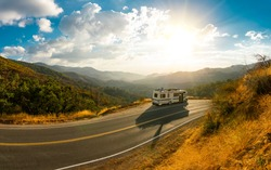 Epic nature mountain view with a road side parked RV motorhome. Travelling lifestyle roadtrip adventure in the USA