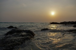epic sunset over beach with rocks and sea, emotion vacation and holidays tourism traveller having fun. Thailand