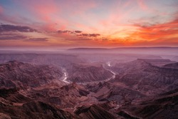Epic sunset over the Fish River Canyon in Namibia, the second largest canyon in the world and the largest in Africa.