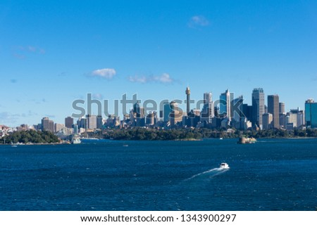 Epic view on Sydney cityscape with ferry boat. Modern urban skyline background