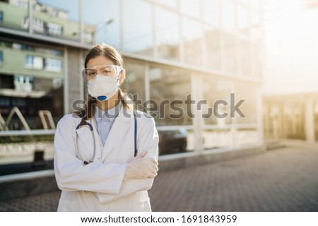 Epidemiologist in front of isolation hospital facility.Coronavirus Covid-19 heroes.Mental strength of medical professional.Emergency room doctor prepared for virus outbreak.Brave physician