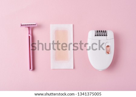Epilator, razor for shaving and wax strips on pink background. Set for depilation, bodycare concept #1341375005