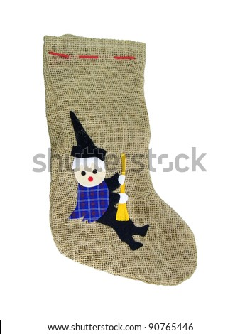 Epiphany sock decorated with old woman riding broom..In Italian tradition an old woman (called Befana) fills socks with sweets for good children and with coal for bad ones on the 5/6 January night