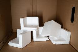 EPS foam in a cardboard box. Expanded Polystyrene foam is a product of styrene monomer.