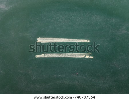 Equal sign, symbol on chalkboard, blackboard texture Stock photo ©