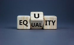 Equality or equity symbol. Turned a cube and changed the word 'equality' to 'equity'. Beautiful grey background. Psychology, business and equality or equity concept. Copy space.