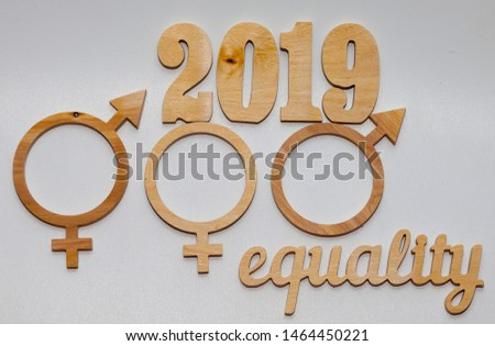 EQUALITY word carved out of plywood. Symbol of gender equality. White background. equality
