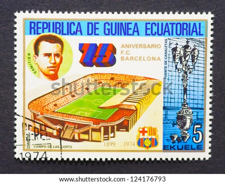EQUATORIAL GUINEA - CIRCA 1974: a postage stamp printed in Equatorial Guinea commemorative of 75 years of FC Barcelona soccer team with an image of Jose Samitier and Les Corts stadium, circa 1974.