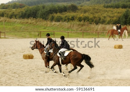 Equestrian Competitions. Riders ride at a gallop.