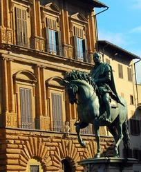 Equestrian Monument of Cosimo I. Ancient bronze monument of a man on a horse in the square  palazzo della Signoria