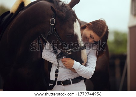 Equestrian sport - young girl rides on horse. Сток-фото ©