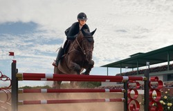 Equestrian sport. Young girl rides on horse on championship.