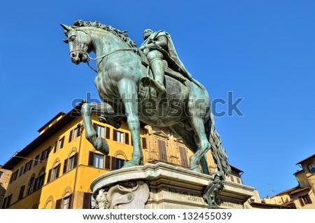 Equestrian statue of Ferdinando I over a blue sky in the Piazza della Signoria, Florence, Italy