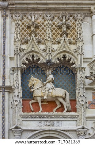 Equestrian statue of the king Louis XII surmounting the entrance door of the castle of Blois in Blois, France
