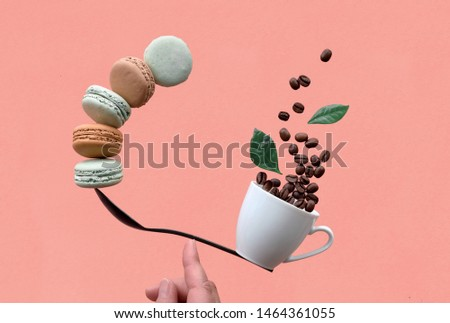 Equilibrium concept flat lay on coral paper background. Balancing cup of coffee and macarons on a spoon