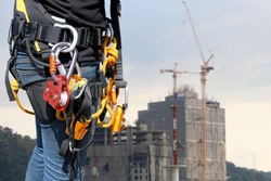 Equipment Abseiling wearing full safety harness for rope access in construction site safety concept