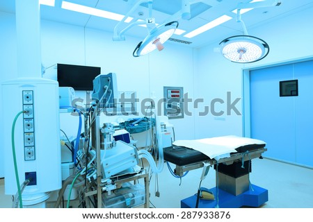 equipment and medical devices in modern operating room take with blue filter